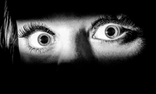 frightened eyes in the dark