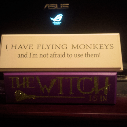 flying monkeys and the witch is in desk signs
