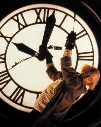 Doc Brown hanging from clock