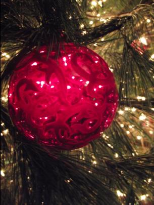 light through red glass ornament