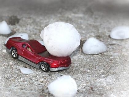 mini car crushed by hail