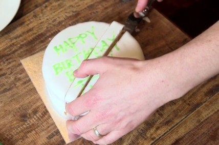 cutting rectangular slice from middle of round cake