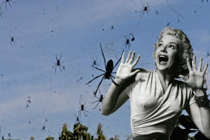 horror flick woman screams as spiders descend