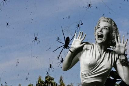 horror flick woman screams as spiders descend