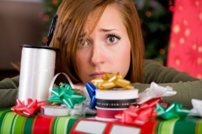 stressed woman wrapping Christmas gifts