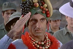 (from M.A.S.H) Max Klinger in a fruit-festooned turban and bold jewelry