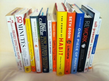 """stack of """"motivational"""" books on various """"guaranteed success systems"""""""