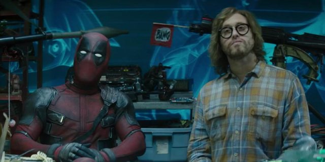 Deadpool and his friend Weasel conduct an interview in front of their arsenal