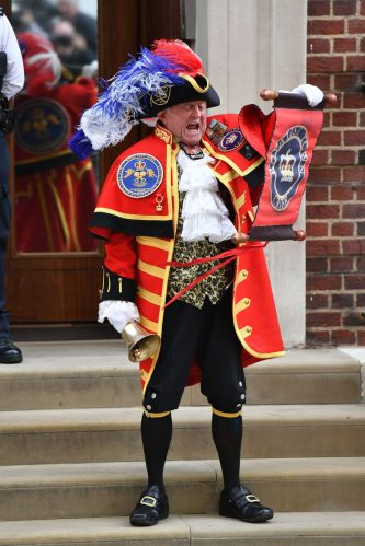 """modern"" town crier announcing the birth of royal baby in Giant Fancy Hat and other over-the-top finery from various eras."