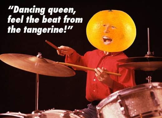 """Drummer with giant tangerine head sings out, """"Dancing queen, feel the beat from the tangerine!"""" (misquote from ABBA's song, Dancing Queen)"""