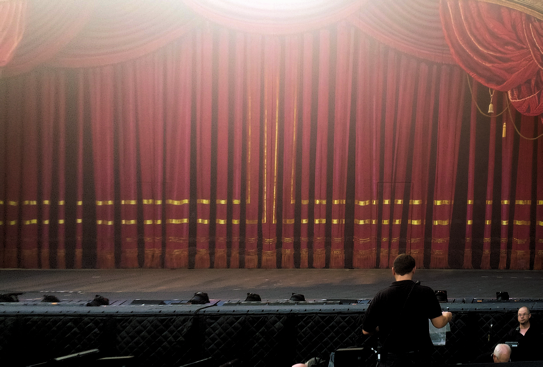 view of the stage from box seats at the Muny outdoor theater, maybe four rows from the front