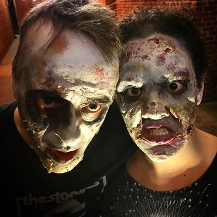 man and woman in zombie makeup