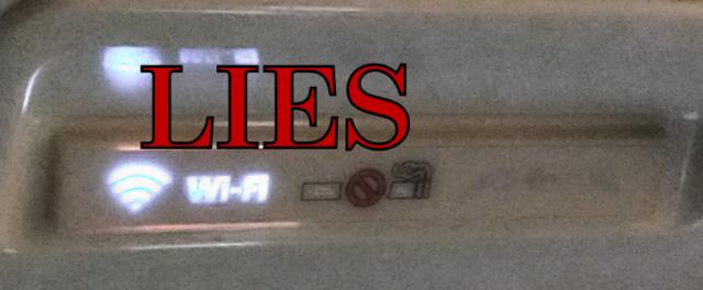 in-flight WiFi/smoking/seatbelt sign; the wifi is a LIE