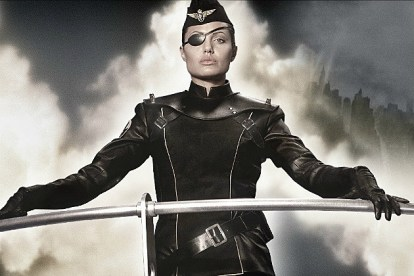 Angelina Jolie (Sky Captain and the World of Tomorrow) in her black uniform and eyepatch, on the deck of her skyship, against a background of clouds and skyscrapers