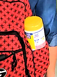closeup of lysol wipes in backpack pocket