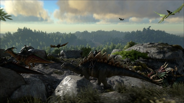 screenshot from Ark: Survival Evolved video game shows rocky, mountainous landscape with saddled dinosaurs bearing humans across the rough terrain while winged dinos swoop and glide overhead