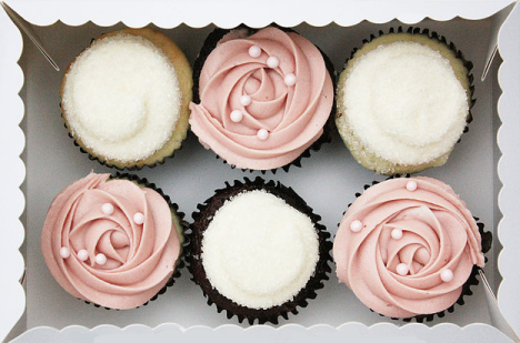 box of six beautifully decorated gourmet cupcakes; three pink roses with pearls, three sugary snowballs