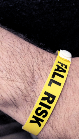 "yellow hospital wristband reads: ""FALL RISK'"