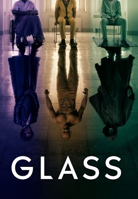 Glass movie poster: a feeble Elijah Price sits in his wheelchair bathed in purple light; an anxious Hedwig leans forward in his chair, garbed in yellow and in a beam of bright yellow light; David Dunn is as relaxed as one can be while chained to the floor, in green scrubs and under an antiseptic greenish hospital light. Mirrored under each of the three is their alter-ego: Mr Glass stands tall and proud in his signature purple coat and leather, The Beast is stripped to the waist, muscles rippling, and The Overseer is hooded in his green slicker, a shadowy protecor.