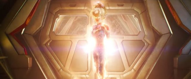 Captain Marvel glows from... everywhere, literally burning and floating