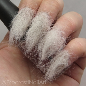 beauty shot of nails covered in a generous coat of cat fur