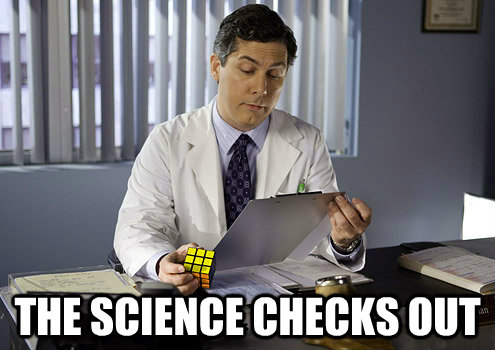 Dr (in white coat and tie) at desk holding Rubik's cube, looking at clipboard; text reads: The science checks out