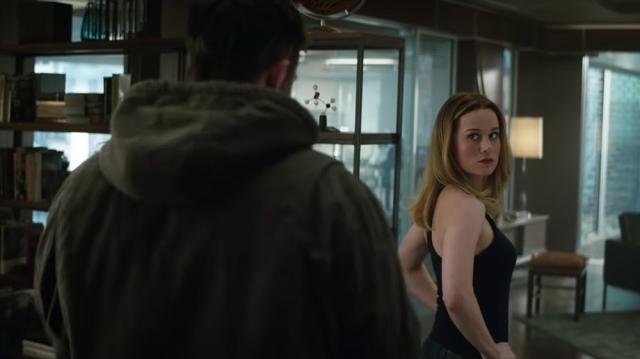 (Avengers: Endgame) Captain Marvel (in civilian clothes) tosses unimpressed glance over her shoulder at Fat Thor, backs to camera