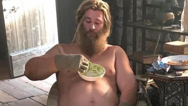 (Avengers: Endgame) Fat Thor eating chips and guacamole off his giant belly