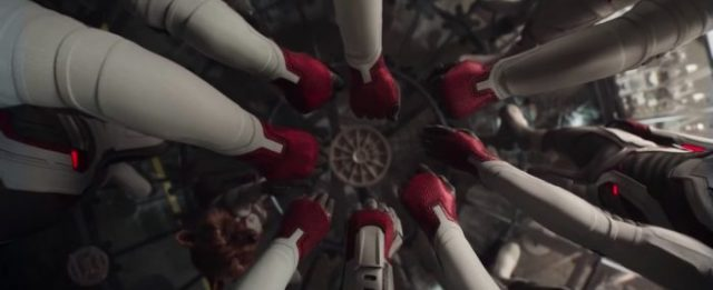 (Avengers: Endgame) various sized arms and paws clad in white plastic uniforms with red gloves form a circle