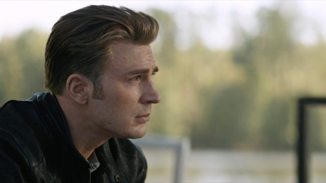 (Avengers: Endgame) Steve Rogers sits looking thoughtful and emotional as a single tear rolls down his cheek