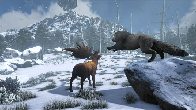 Ark screenshot: direwolf leaping onto moose amid snowy mountains and bare trees
