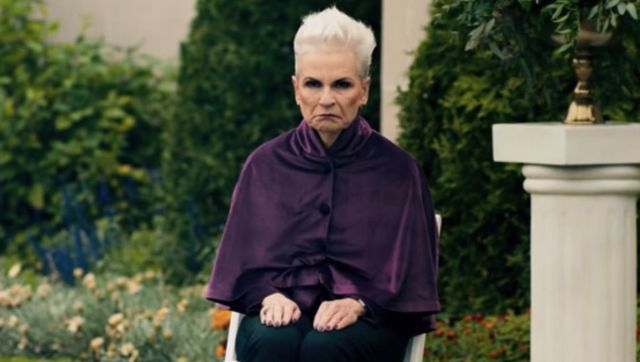 (Ready or not) Creepy Aunt Helene sits dour and eerie amid a colorful garden