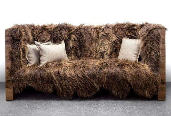 raccoon fur and wood loveseat