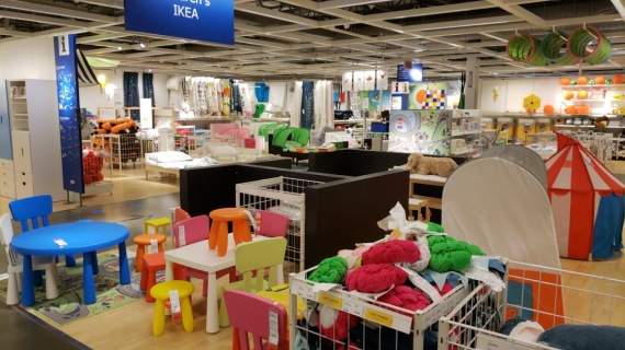 ikea kids section, full of tiny furniture in bright colors