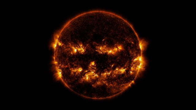 photo of the sun with flares in the shape of jack-o'-lantern grin