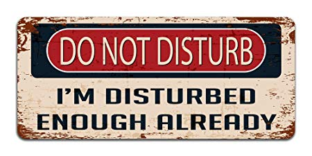 beat-up sign reads: Do not disturb; I'm disturbed enough already